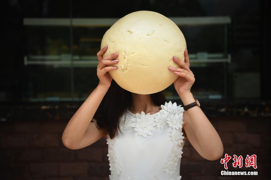 重庆一食店下载3斤重的馒头巨型比人脸还大淘宝出售情趣欲晓图片